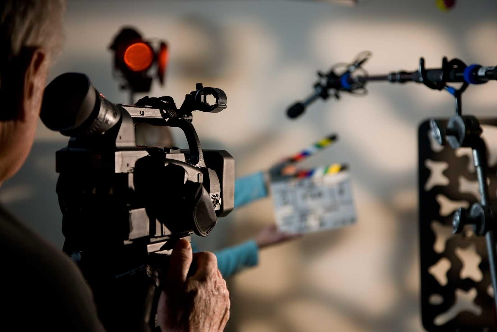 video production marketing strategy - man holding a camera and ready for shooting